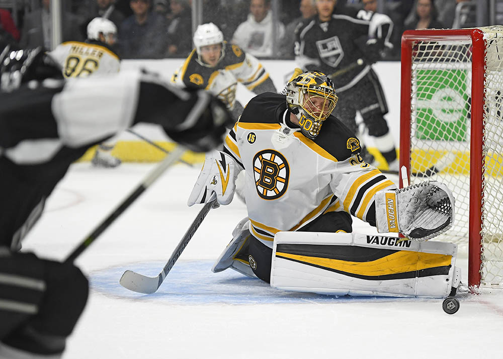 Boston Bruins goalie Anton Khudobin stops a shot by Los Angeles Kings defenseman Kevin Gravel, foreground left, during the second period of Thursday's game in Los Angeles. Khudobin was solid in just his ninth start of the season for the Bruins.