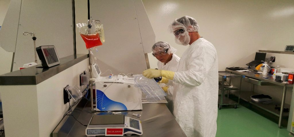 Cell therapy specialists at Kite Pharma's manufacturing facility in El Segundo, Calif., prepare blood cells from a patient to be engineered in the lab to fight cancer.