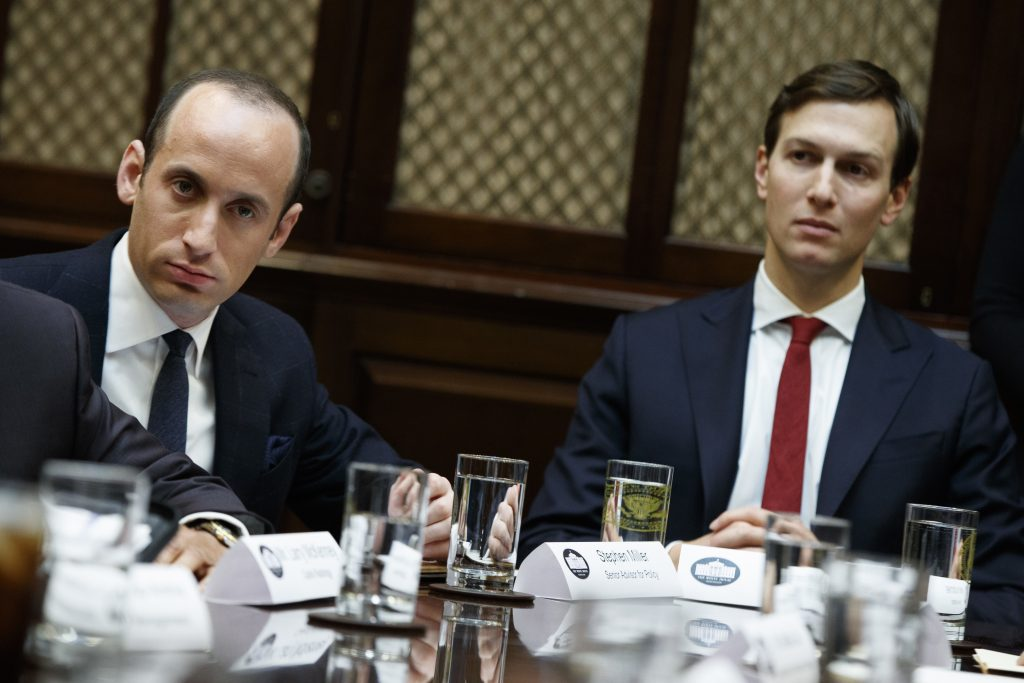 Senior White House adviser Stephen Miller, left, and Jared Kushner, President Trump's son-in-law, listen as Trump speaks during a meeting with business leaders in the White House on Jan. 30.