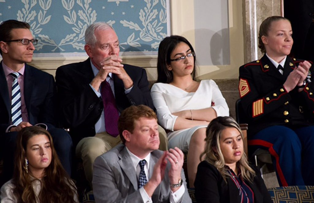 Banah Al-Hanfy, in the back row, watches President Trump give his speech to Congress on Tuesday night in the Capitol. Hours earlier, she spoke at a news conference with other guests who have been, or could be, affected by Trump's immigration policies.