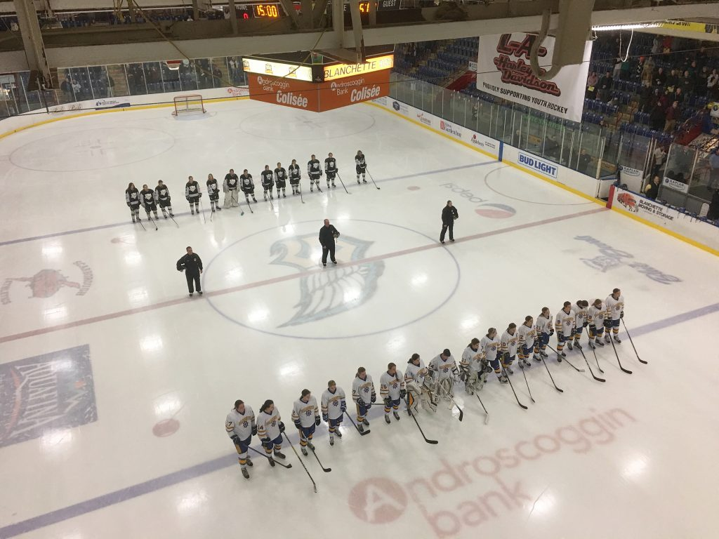 Falmouth, in front, and St. Dom's line up before the start of the girls state championship in Lewiston.