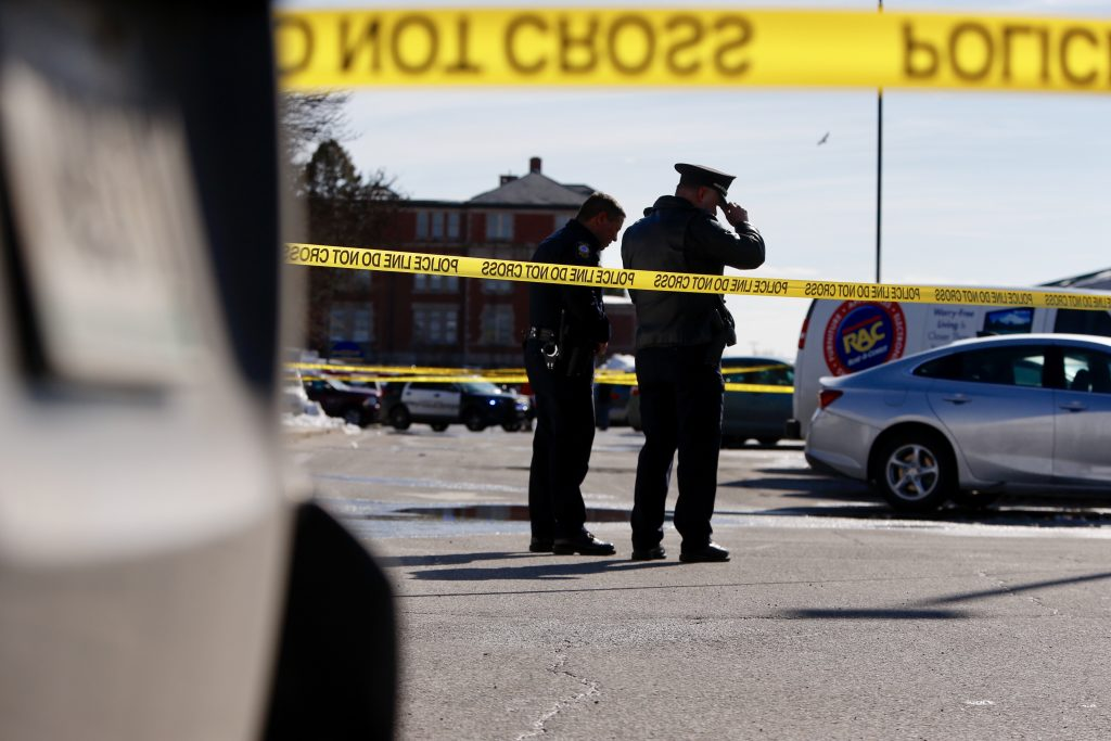 Portland police examine the scene where an officer shot Chance Baker at Union Station Plaza on Saturday.