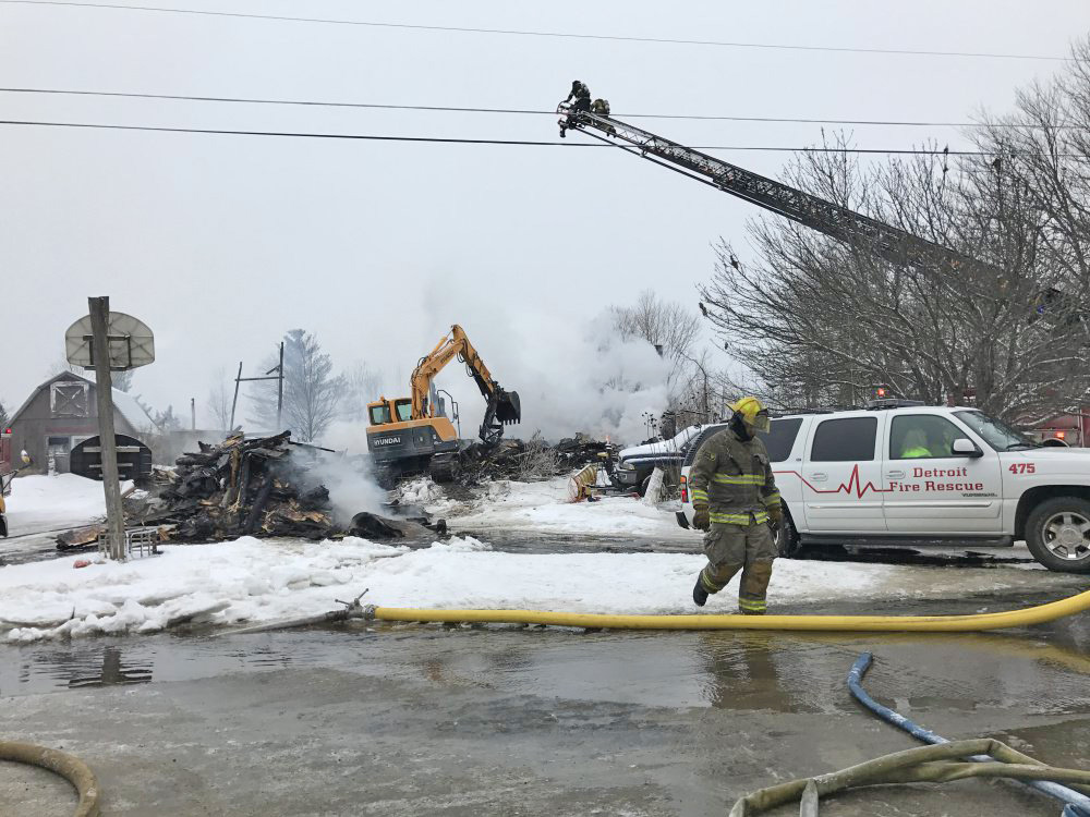An excavator begins tearing down the remains of an apartment house on Square Road in Palmyra that was destroyed by fire early Tuesday morning, leaving two people dead and six others displaced but uninjured.