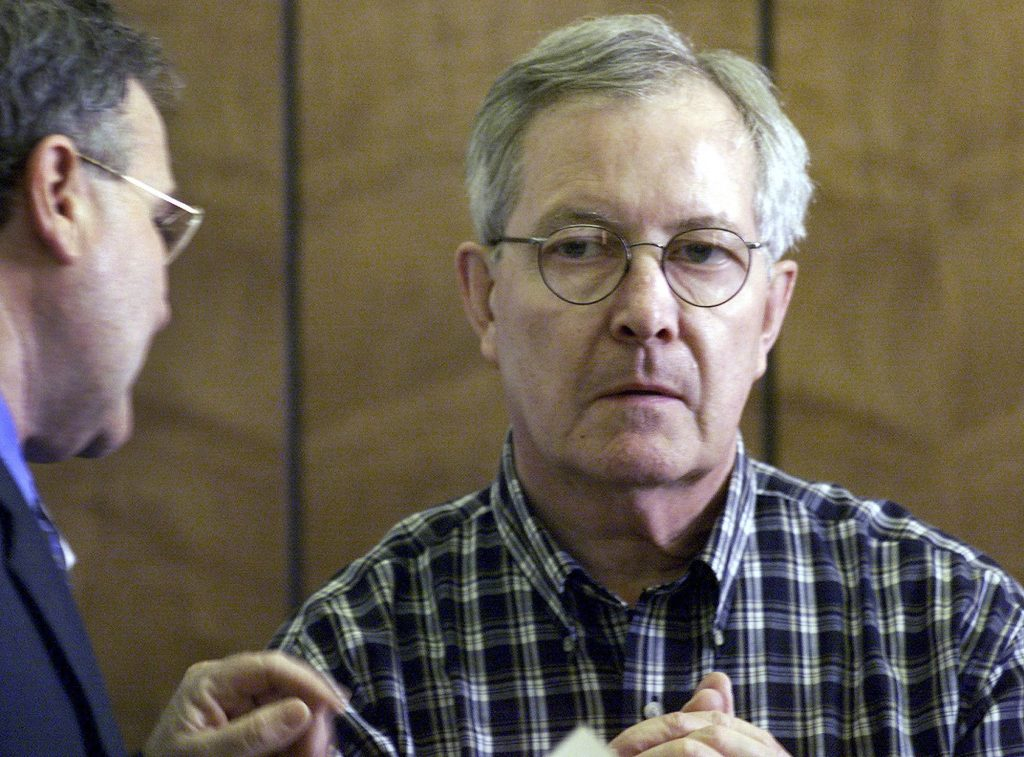 Former Catholic priest Ronald Paquin, shown in court in Haverhill, Mass., in 2002, faces 31 charges of sexual abuse in Maine dating back to the 1980s.
