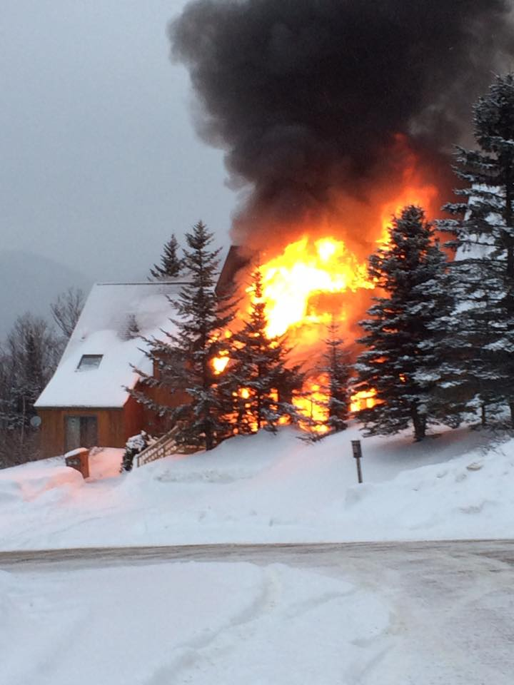A condominium building burns Tuesday at Saddleback Mountain.
