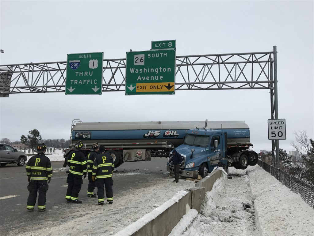 This tanker truck jackknifed and crashed into the pedestrian path in the southbound lanes of I-295 on Tukey's Bridge in Portland on Sunday.