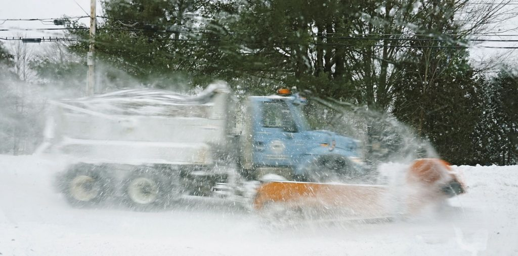 A plow truck clears snow from Fletcher Street in Kennebunk during the storm  Monday morning. The National Weather Service warns that today's storm  will bring the heaviest snow during the afternoon and evening hours, and this evening's commute could be treacherous.