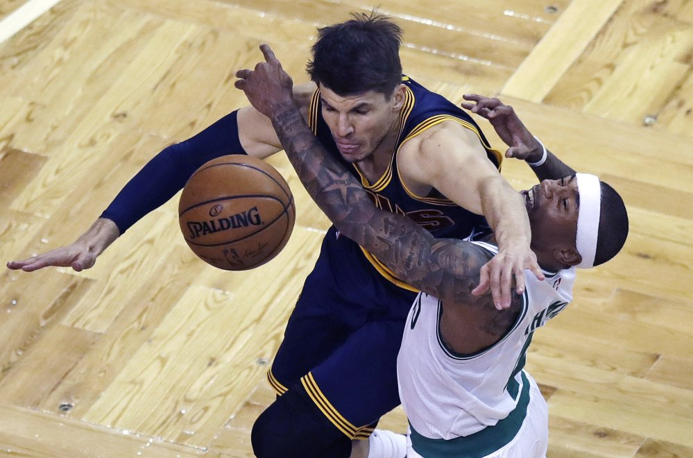 Boston's Isaiah Thomas, right, and Cleveland's Kyle Korver collide while battling for the ball in the first quarter Wednesday night in Boston.