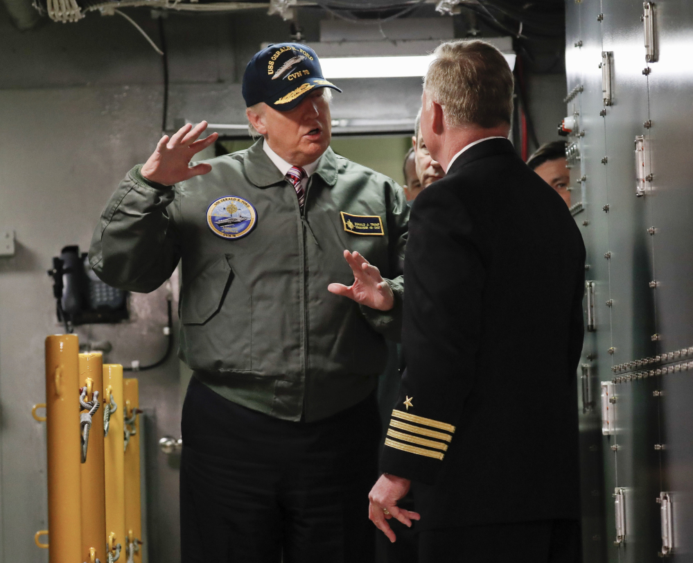 President Trump talks with Capt. Richard