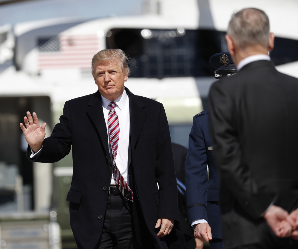 President Trump approaches Defense Secretary Jim Mattis before they board Air Force One at Andrews Air Force Base, Md., on Thursday. Trump traveled Virginia to meet with sailors and shipbuilders aboard the Gerald R. Ford CVN 78 aircraft carrier, a $12.9 billion warship, that is expected to be commissioned this year.