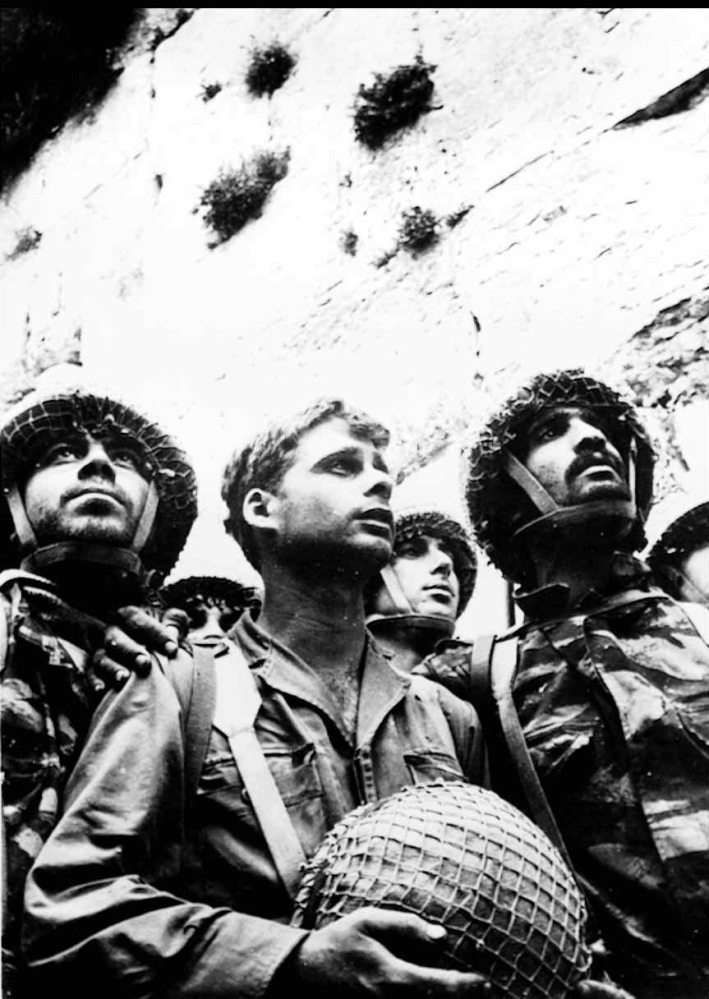 Israeli soldiers take their first look at the Jewish religion's holiest place, the Western Wall in the old city of Jerusalem, after it was captured from Jordan on June 8, 1967.