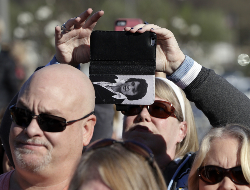 A fan takes a picture at Graceland on Thursday in Memphis, Tenn. The $45 million complex replaces the aging buildings which house Presley-related exhibits. Associated Press/Mark Humphrey