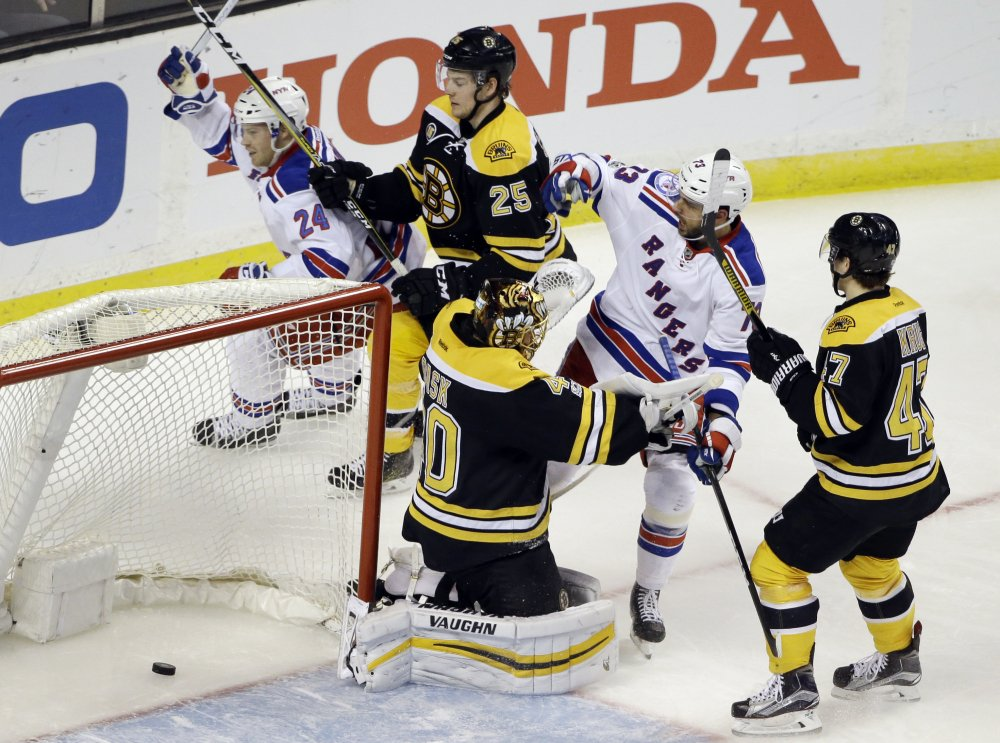 Rangers center Oscar Lindberg celebrates his goal in front of Bruins goalie Tuukka Rask in the third period Thursday night in Boston.
