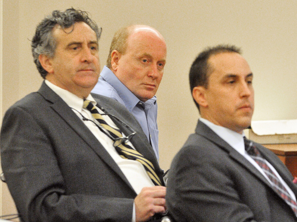 Roland Cummings, center, is flanked by his defense attorneys, Ronald Bourget, left, and Darrick Banda, in the Capital Judicial Center in Augusta during his trial in November 2015, when he was found guilty of murder.