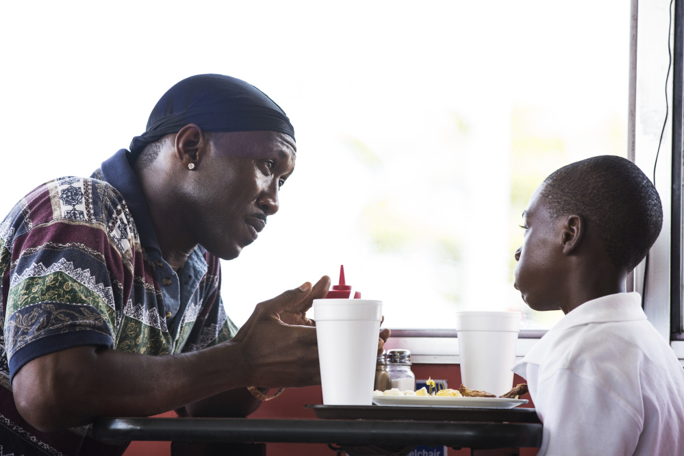 "Mahershala Ali, left, and Alex Hibbert in ""Moonlight."" Ali won the supporting actor Oscar and the film won best picture."