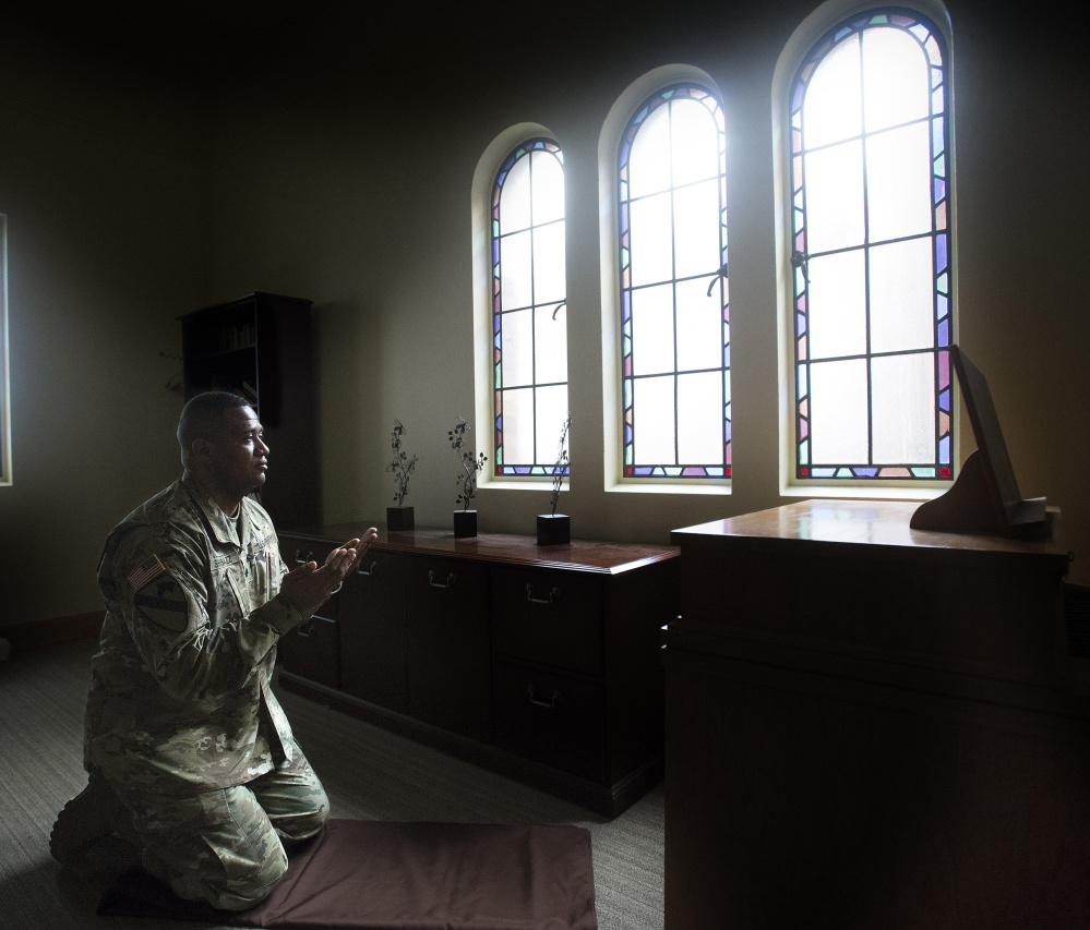 Army Lt. Col. Khallid Shabazz prays five time a day as an Islamic chaplain at the Main Post Chapel on Joint Base Lewis-McChord near Tacoma, Wash.