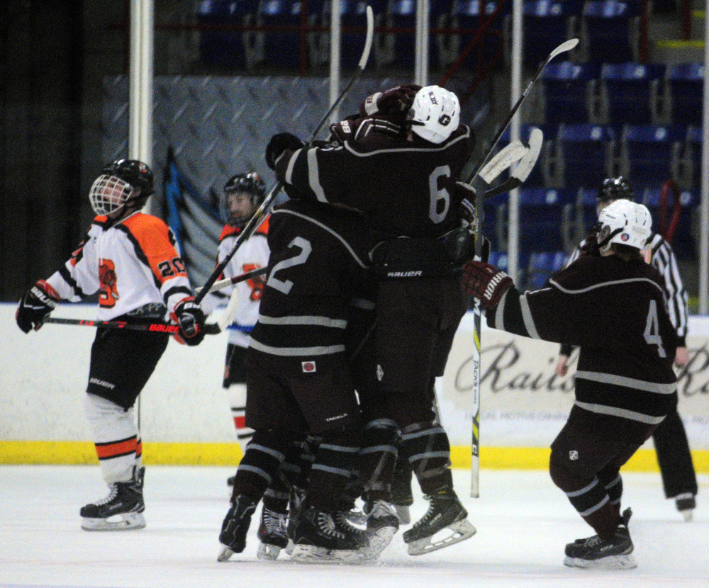 Greely players celebrate a first-period goal by Jake MacDonald that started the Rangers on their way to a 5-2 win over Gardiner in a Class B South semifinal Friday night at the Androscoggin Bank Colisee in Lewiston.