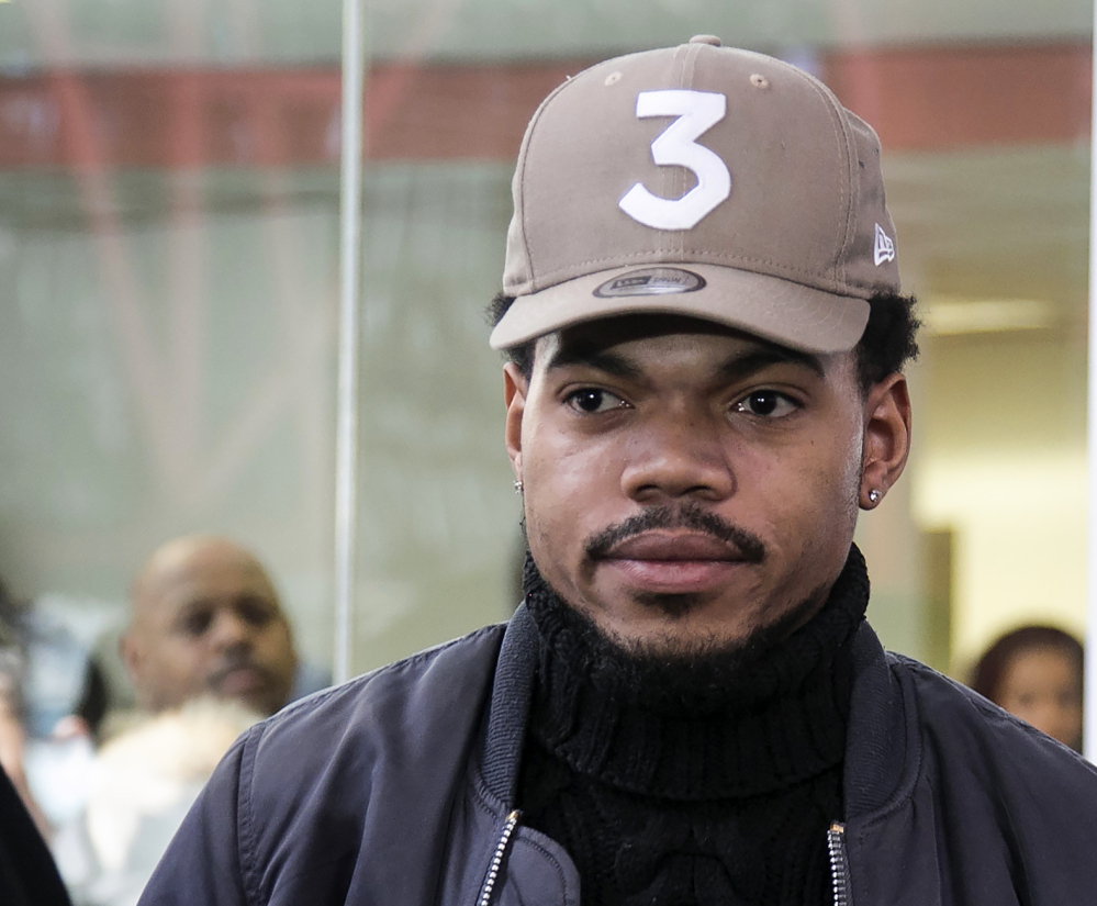 Chance the Rapper leaves a meeting with Illinois Gov. Bruce Rauner on Friday.