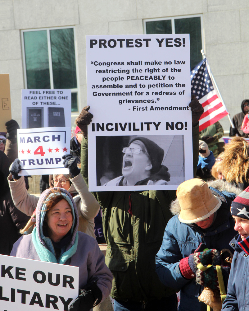 Trump supporters gather on Saturday in front of the Burton M. Cross State Office Building at a March 4 Trump rally in Augusta. The event was part of a nationwide show of support for President Donald Trump.