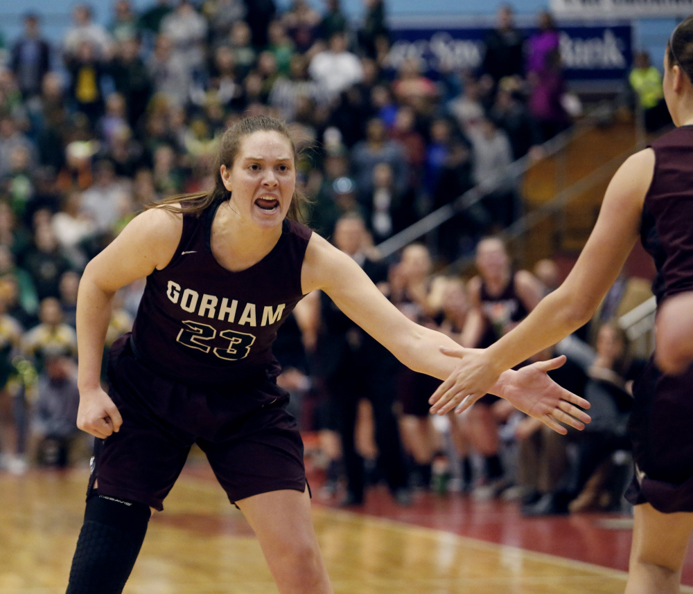 MARCH 4: Emily Esposito of Gorham celebrates with a teammate after scoring a basket during the Class AA girls' basketball state final Saturday against Oxford Hills. Esposito finished with 20 points, helping the Rams finish their second straight undefeated season.