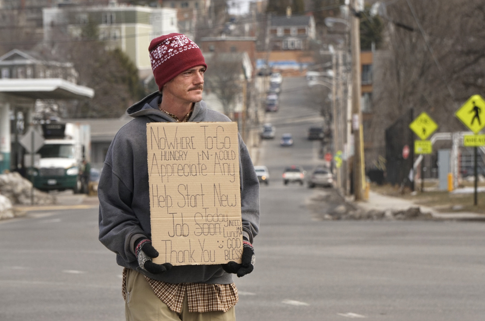 """Dana Burnell panhandles on the median strip on Somerset Street in Portland late last month. But Burnell says he'd rather be working, and a pilot program called """"Portland Opportunity Crew"""" could soon make that happen. It would also connect the city's most needy with social services."""