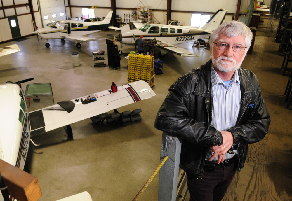 David Smith, who recently retired as chief pilot, poses for a photo in a hangar last week at Maine Instrument Flight in Augusta. Smith said that he still flies several charters a week but is done with administrative duties the chief's job entailed.