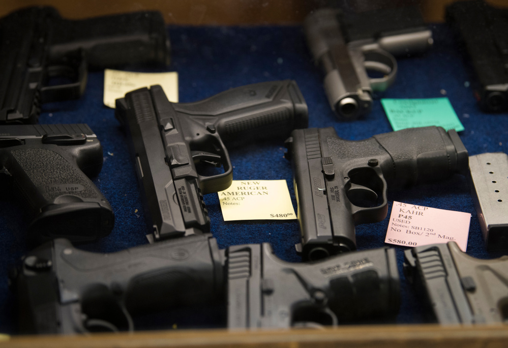 Pistols are for sale at the TargetMaster gun store and shooting range in Garland, Texas, on Friday.