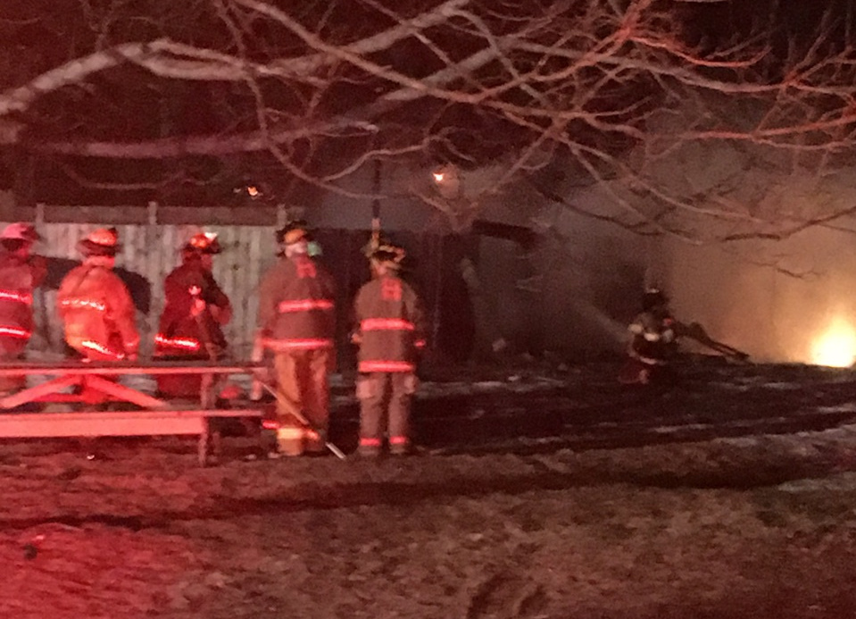 Firefighters from five communities battle a barn fire Sunday night in Hallowell. The blaze spread from a wood-burning stove used to make maple syrup inside the barn.