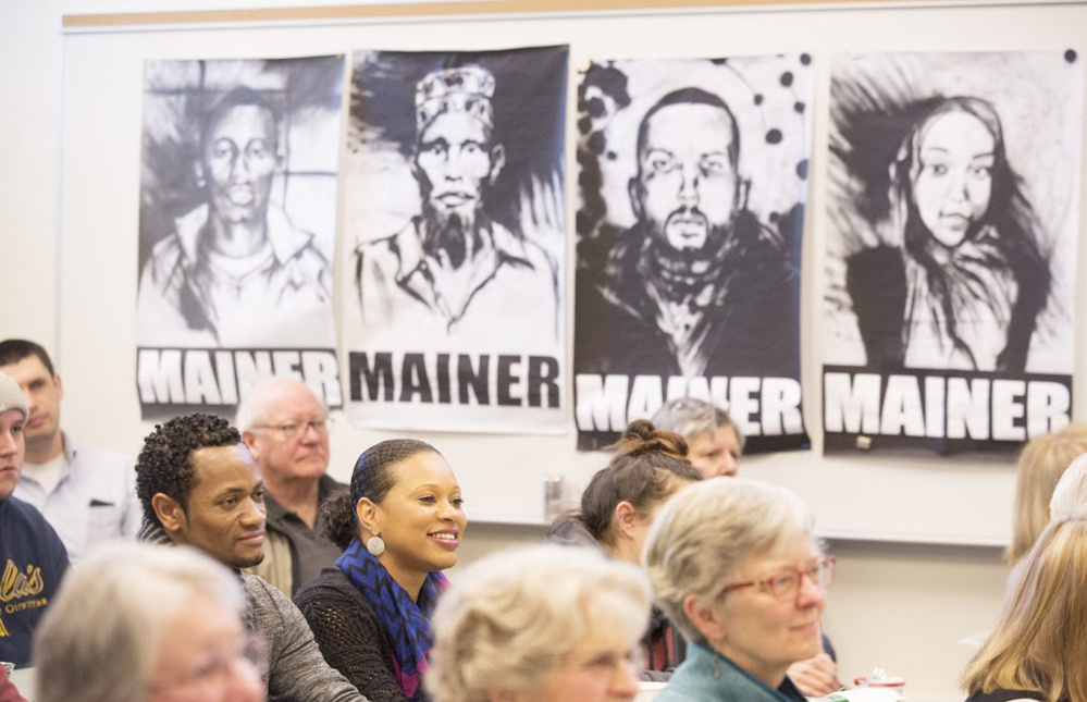 Kennebec Community College student Flavia Oilveira sits with her husband, Nelson Oliveira, during a Lunch and Learn at the Holocaust and Human Rights Center of Maine titled,