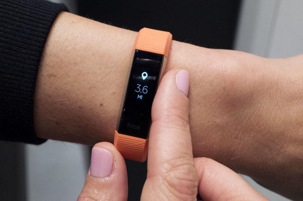 Fitbit's new Alta HR device has heart rate monitoring and seven days of battery life. It goes on sale soon for about $150.