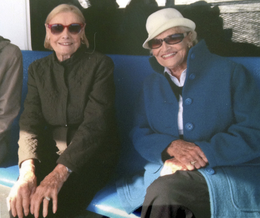 Martha Williams, left, of East Providence, R.I., sits with her twin, Jean Haley of Barrington, R.I., on a ferry en route to the Massachusetts island of Nantucket in 2015.