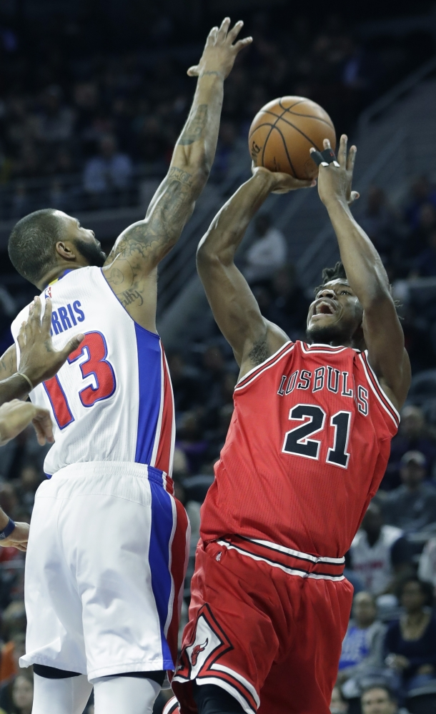 Chicago's Jimmy Butler takes a shot over Detroit's Marcus Morris during the Pistons' 109-95 win Monday in Auburn Hills, Michigan.