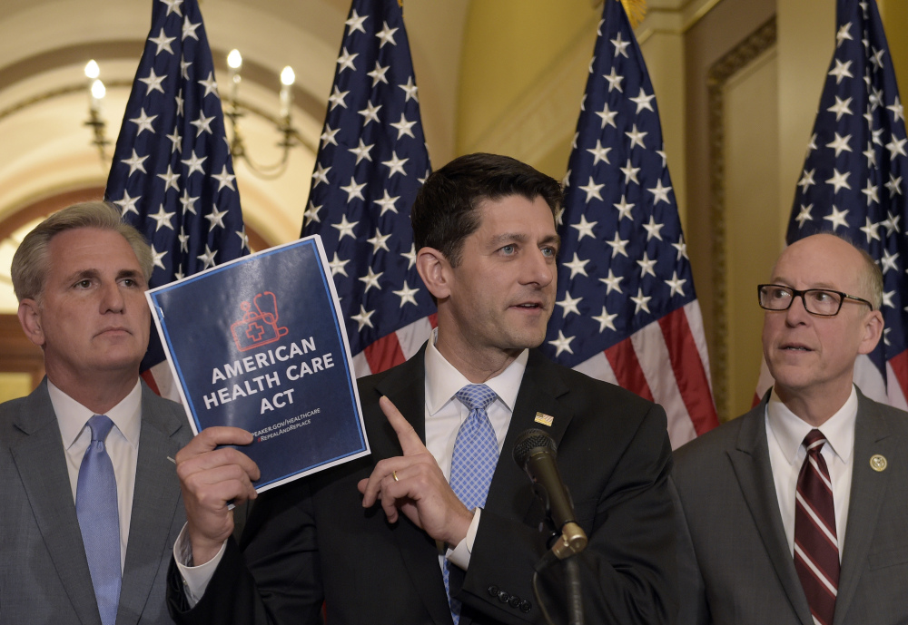 House Speaker Paul Ryan of Wisconsin, center, with Energy and Commerce Committee Chairman Greg Walden, R-Oregon, right, and House Majority Whip Kevin McCarthy, R-California, left, speaks during a news conference on the American Health Care Act on Capitol Hill in Washington on Tuesday.