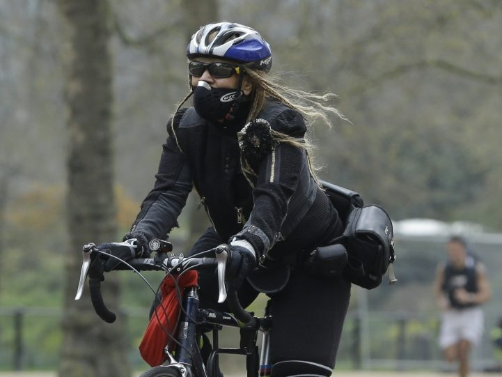 A cyclist wears a pollution protection mask along The Mall in London. The United Kingdom has the largest fleet of diesel vehicles in Europe. Diesel emits less carbon dioxide, but the emissions are up to 10 times more toxic than gas fumes.