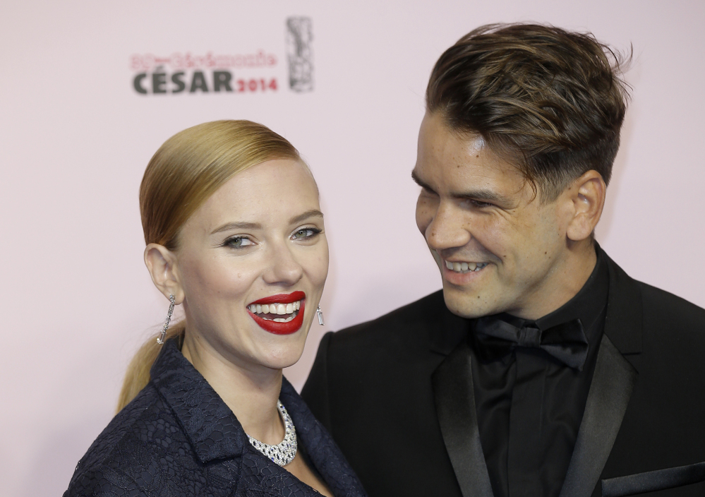 Actress Scarlett Johansson and her partner Romain Dauriac appear at an awards show. Johansson filed for divorce from Dauriac on March 7 in New York.