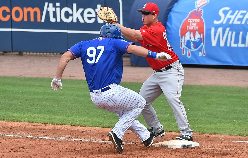Mets designated hitter Tim Tebow is doubled off first base on a line drive during New York's 8-7 spring training victory over the Red Sox on Wednesday at Port St. Lucie, Fla. Tebow went 0 for 3 with two strikeouts.
