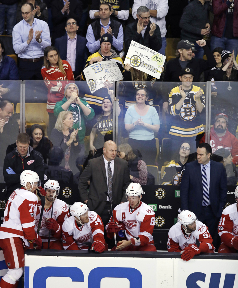 Bruins fans celebrate after the fourth goal of the first period against the Detroit Red Wings in Boston on Wednesday. (Photos by Charles Krupa/Associated Press)