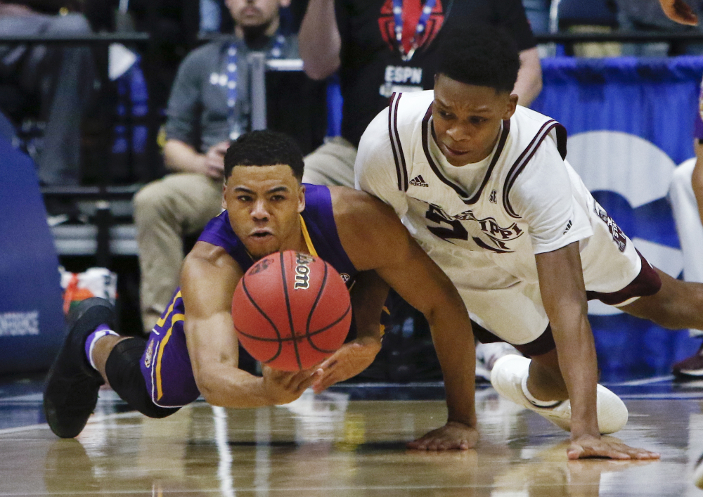 LSU guard Jalyn Patterson, left, and Mississippi State guard Tyson Carter dive for the ball during the first half of an NCAA college basketball game at the Southeastern Conference tournament Wednesday, March 8, 2017, in Nashville, Tenn. (AP Photo/Wade Payne)