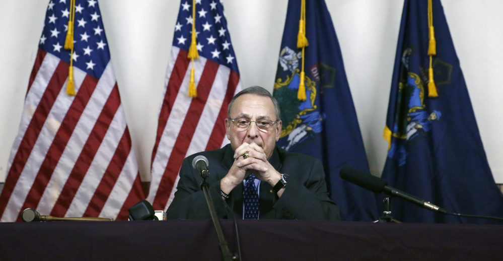 Gov. Paul LePage pauses during his remarks at a town hall-style meeting on Wednesday at AMVETS Post 2 in Yarmouth.