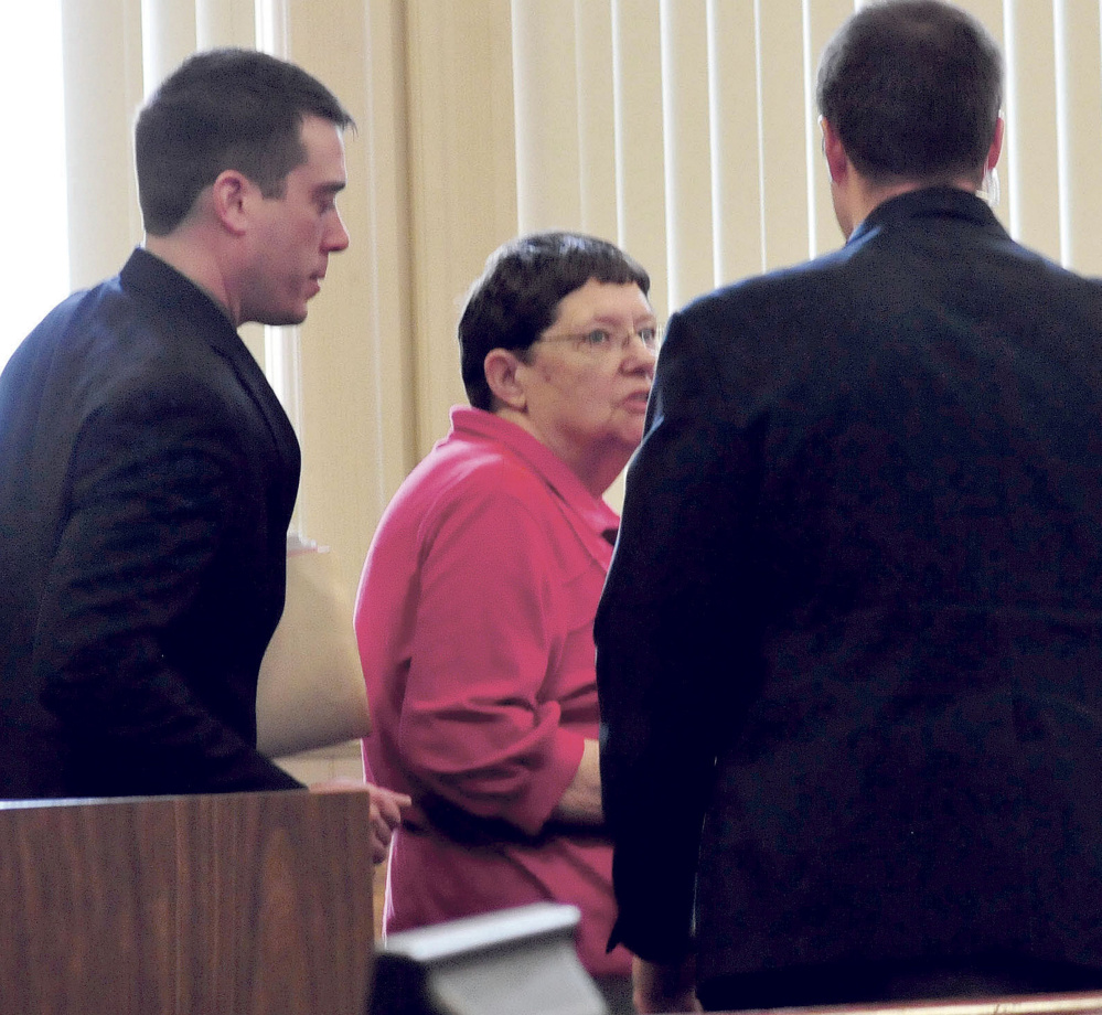 Mary O'Donal and her attorney, Christopher Berryment, left, speak with a court officer after O'Donal was sentenced Thursday in Franklin County Superior Court to three years in prison, with all but 30 days suspended, and ordered to pay restitution for stealing more than $300,000 from the Care and Share Food Closet in Farmington.