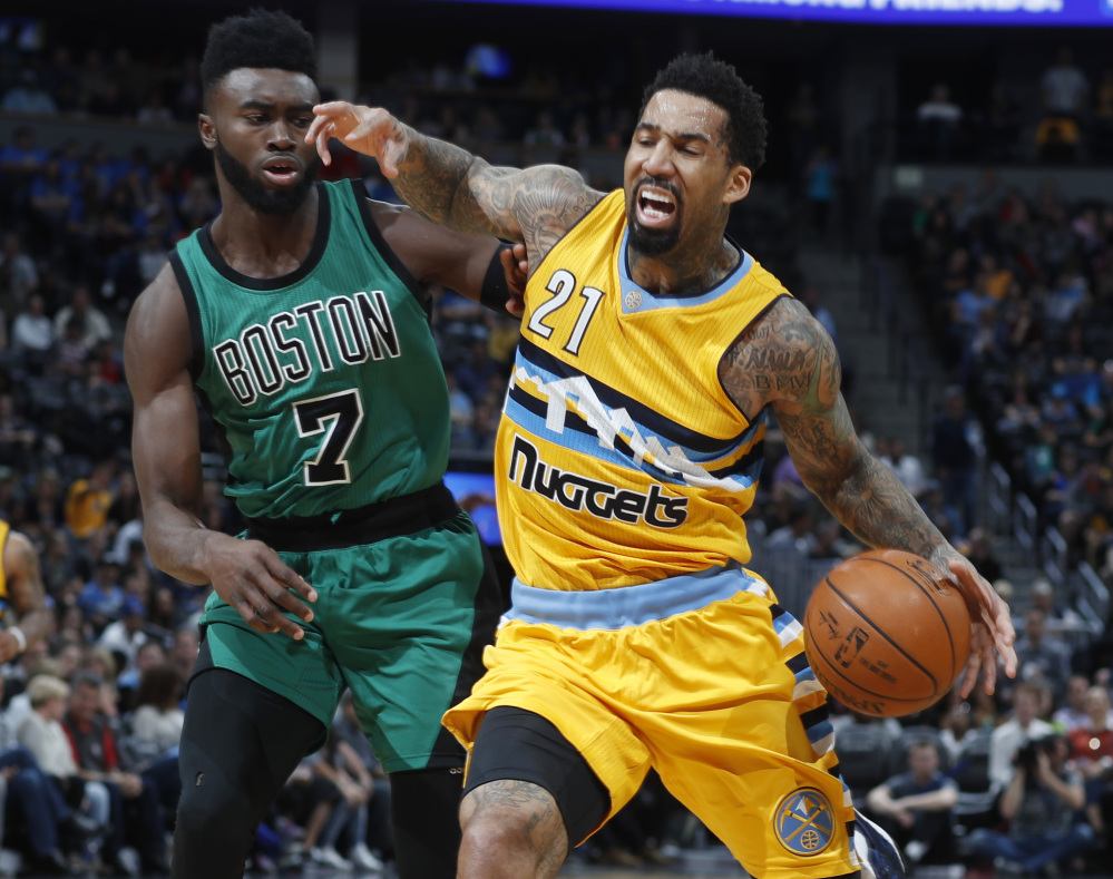 Nuggets forward Wilson Chandler drives past Celtics forward Jaylen Brown in the first half Friday night in Denver.