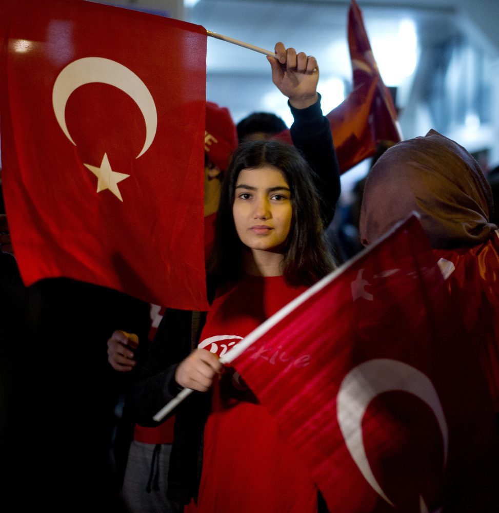 Demonstrators wave Turkish flags outside the Turkish consulate Saturday in Rotterdam, where Turkish Foreign Minister Mevlut Cavusoglu was due to campaign for a referendum next month on constitutional reforms in Turkey.