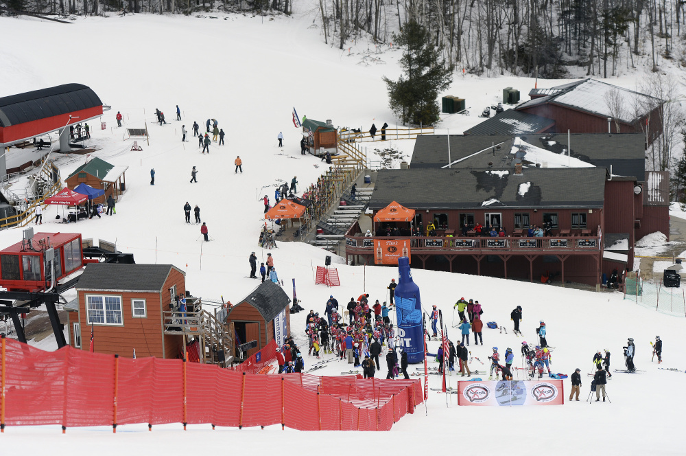 Skiers and spectators congregate near the finish line of the World Ski Tour's initial event at Sunday River. The president of the Tour, Ed Rogers of Bath, now has video of a race that he can present to potential sponsors.