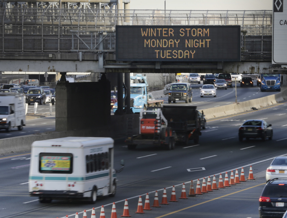 A sign warns motorists about an impending winter storm in Fort Lee, N.J., on Monday. The Northeast is bracing for a blizzard expected to sweep the New York region with possibly the season's biggest snowstorm.