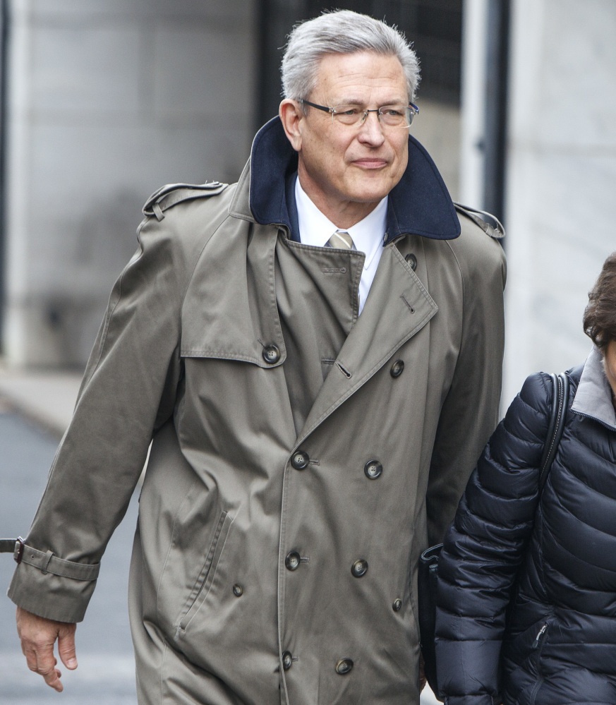 Former Penn State Athletic Director Tim Curley leaves the Dauphin County Courthouse in Harrisburg, Pa., Monday after pleading guilty to endangering the welfare of a child.