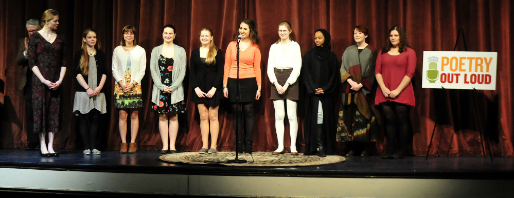 The 10 high school students assemble on stage prior to competing in the Poetry Out Loud finals at the Waterville Opera House on Monday. The winner of the state finals – Gabrielle Cooper of Gardiner Area High School – will move on to national competition in Washington, D.C. The event is organized by the National Endowment for the Arts and Poetry Foundation and administered by the Maine Arts Commission.