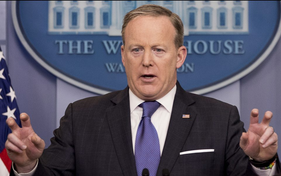 Press secretary Sean Spicer speaks during the daily press briefing at the White House on Monday. Spicer tried to clarify President Trump's comments, saying,