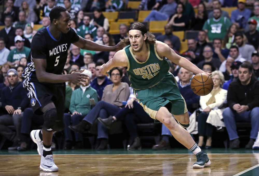 Celtics center Kelly Olynyk drives to the basket against Minnesota's Gorgui Dieng in the first quarter of Wednesday's game in Boston.