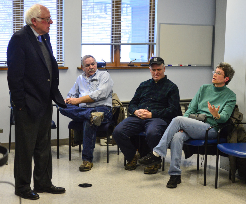 Lisa Lofting speaks about her concerns about women's health for veterans to U.S. Senator Bernie Sanders during a visit to the Brattleboro, Vt., VA., clinic on Thursday, Sanders urged Vermonters and all Americans to oppose President Trump's agenda.