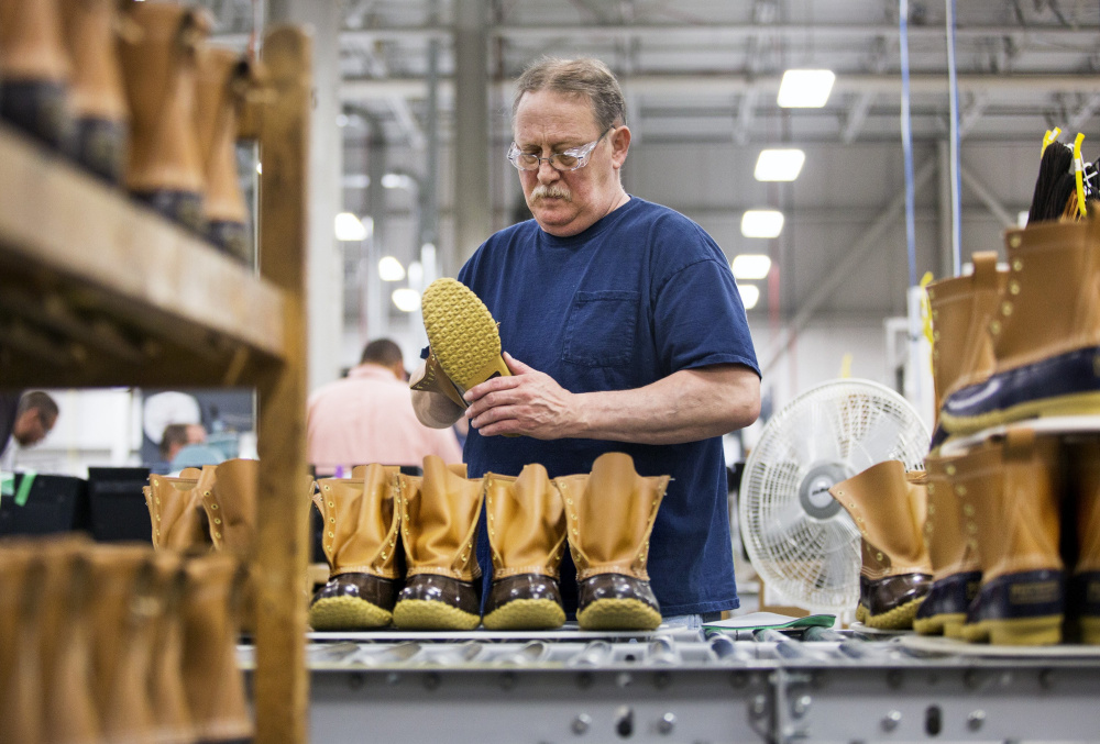 Jack Weaver assembles Bean boots at the L.L. Bean boot factory in Brunswick in September. Around 6,000 L.L. Bean employees will receive a 3 percent annual bonus based on sales at the outdoor gear retailer. The Freeport-based company announced Friday that its 2016 sales came in at just over $1.6 billion, similar to sales in 2015 and 2014.